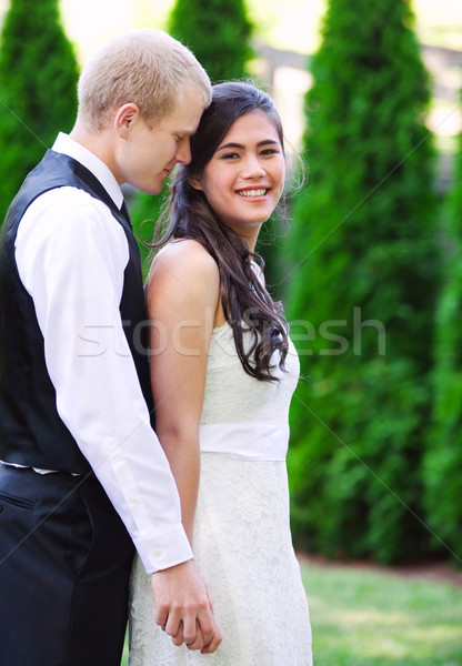 Caucasian groom holding his biracial bride, smiling. Diverse cou Stock photo © jarenwicklund