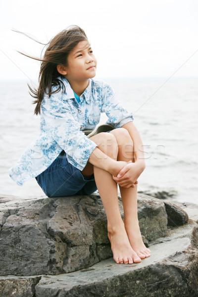Nine year old girl sitting by lake Stock photo © jarenwicklund