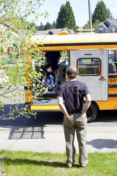 Apa vár mozgássérült fiú el iskolabusz Stock fotó © jarenwicklund