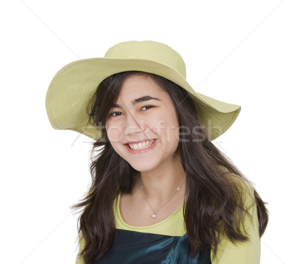 Smiling teen girl in green dress and lime green hat, Stock photo © jarenwicklund