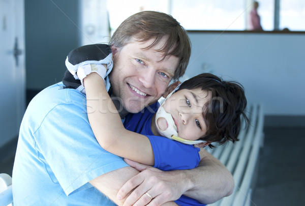 Disabled boy giving father a big hug Stock photo © jarenwicklund