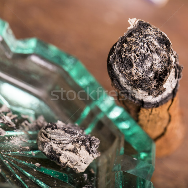 Expensive hand-rolled cigar on a while background Stock photo © jarin13