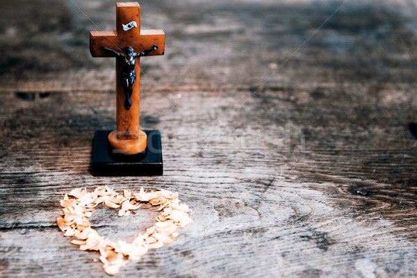 Beautiful old cross with jesus and heart from leafs on the old w Stock photo © jarin13