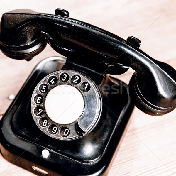 Velho preto telefone poeira isolado Foto stock © jarin13