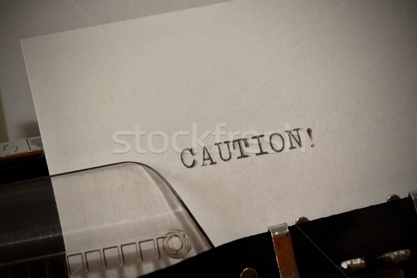 Caution text typed on old black typwriter Stock photo © jarin13