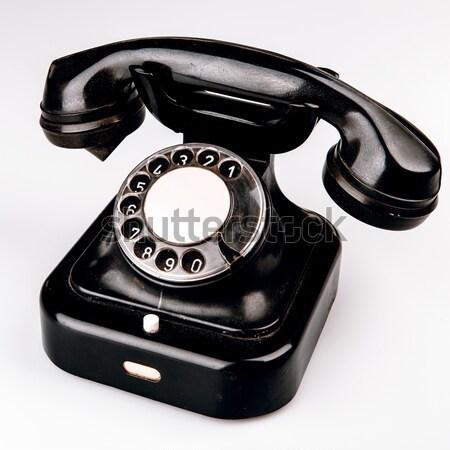 Eski siyah telefon toz beyaz yalıtılmış Stok fotoğraf © jarin13