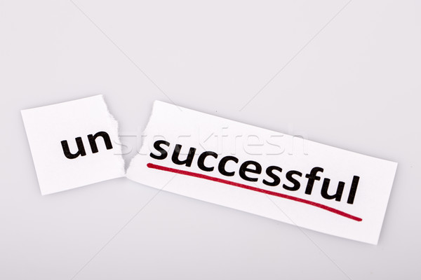 The word unsuccessful changed to successful on torn paper Stock photo © jarin13