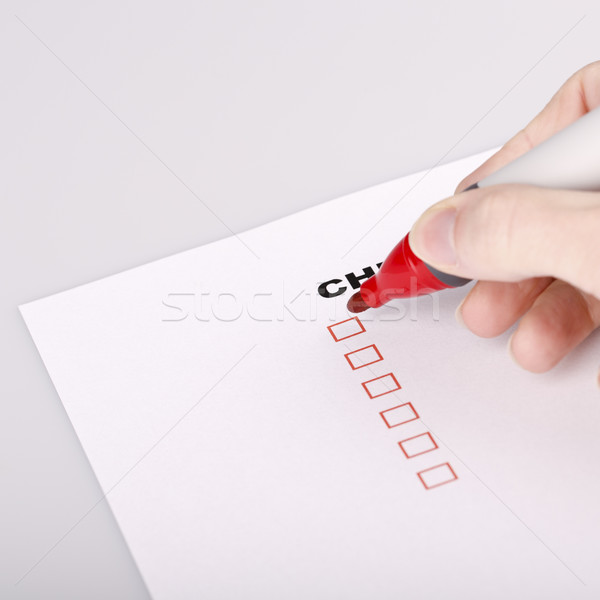 Stock photo: Checklist on white with marker and woman hand