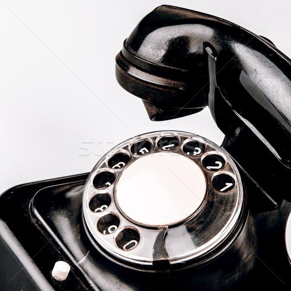 Vecchio nero telefono polvere bianco isolato Foto d'archivio © jarin13