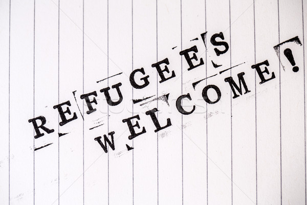 refugees welcome text on paper Stock photo © jarin13