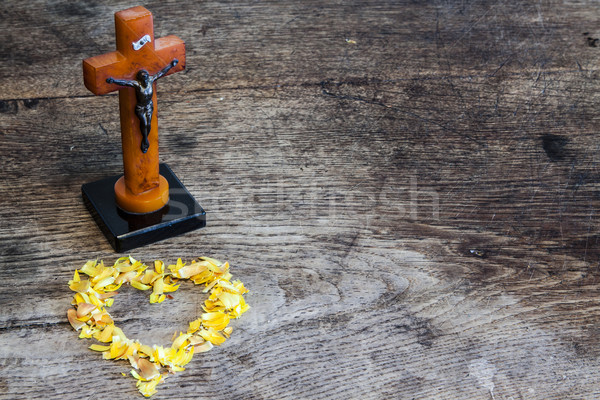 Beautiful old cross with jesus and heart from leafs on the old wooden floor Stock photo © jarin13