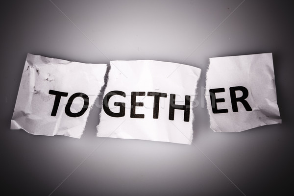 'TOGETHER' word written on torn  paper Stock photo © jarin13