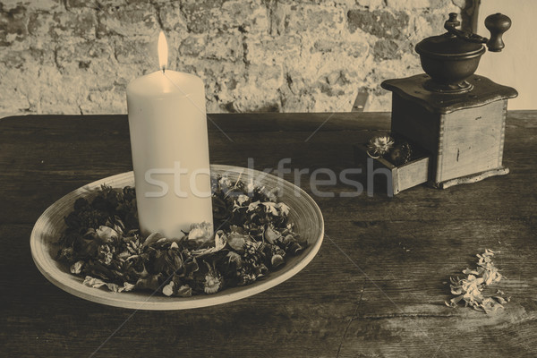Candle on the wooden plate with coffee mill Stock photo © jarin13