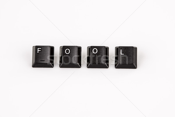 fool word written with black computer buttons over white Stock photo © jarin13