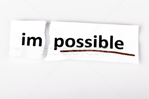 The word impossible changed to possible on torn paper Stock photo © jarin13