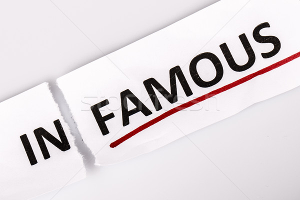 The word infamous changed to famous on torn paper Stock photo © jarin13
