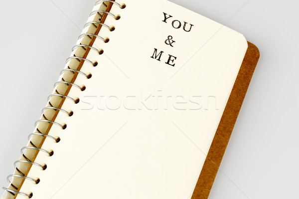 you and me text in emty book or diary Stock photo © jarin13