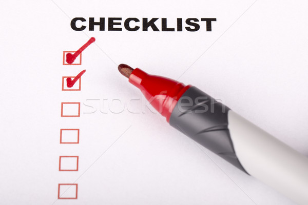 Checklist on white with marker  Stock photo © jarin13