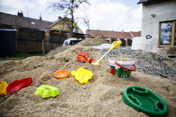 Crianças brinquedos areia vermelho azul verde Foto stock © jarin13