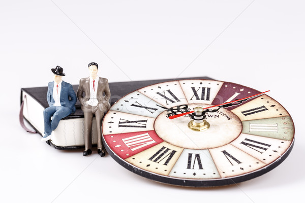 model of man sitting on organizer or planner with old clock Stock photo © jarin13