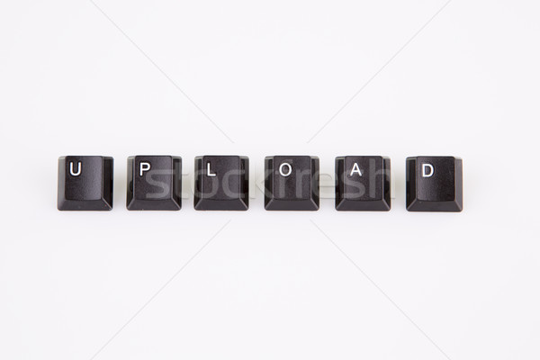 Stock photo: upload word written with black computer buttons over white