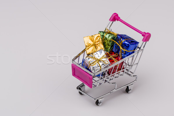 Christmas gifts in shopping trolley, isolated on white Stock photo © jarin13