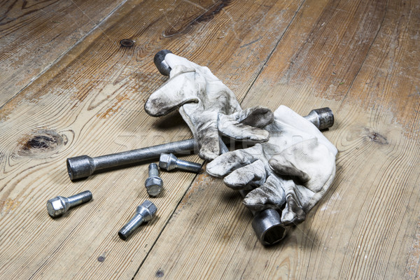 old used wrench with screw and dirty gloves Stock photo © jarin13