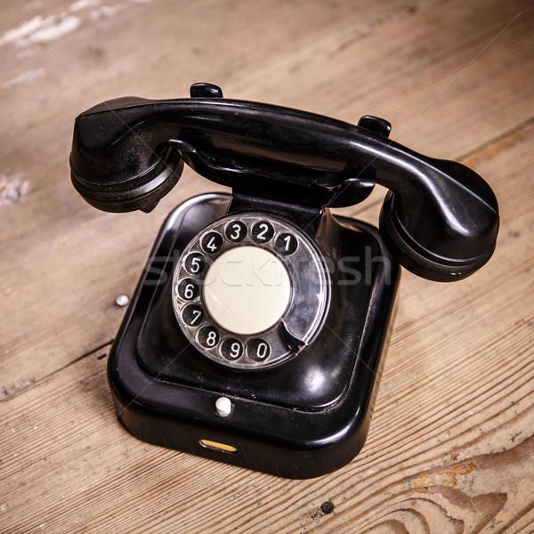 Vieux noir téléphone poussière isolé Photo stock © jarin13