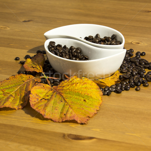 Stock photo: cups with coffee beans on a wooden table