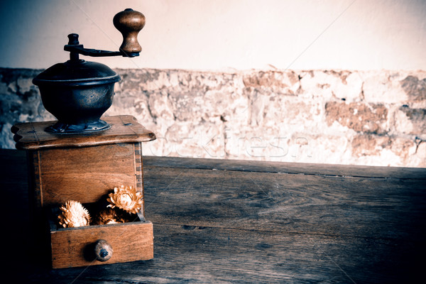 Vintage wooden coffee mill grinder with yellow flowers in open d Stock photo © jarin13