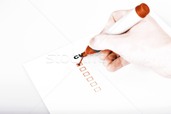 Checklist on white with marker and woman hand Stock photo © jarin13