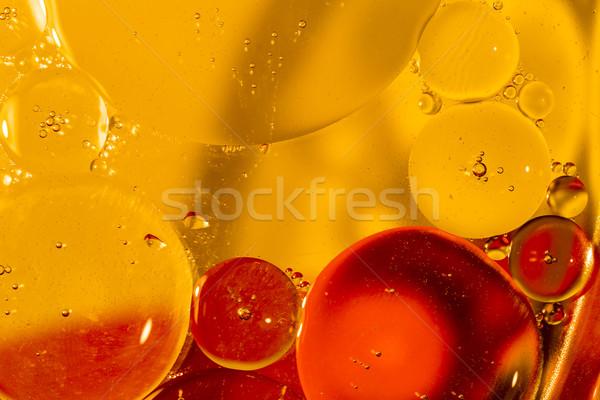 Olie druppels wateroppervlak kleur water textuur Stockfoto © jarin13