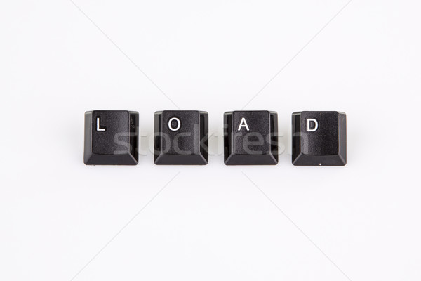 load word written with black computer buttons over white Stock photo © jarin13
