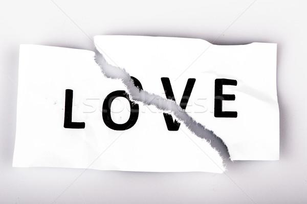 Liefde woord geschreven gescheurd papier witte papier Stockfoto © jarin13