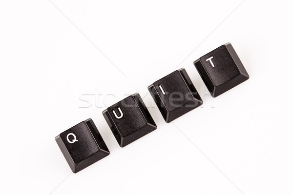 Stock photo: quit word written with black computer buttons over white