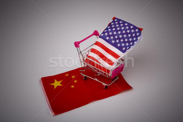 Stock photo: Shopping cart with USA flag on China flag