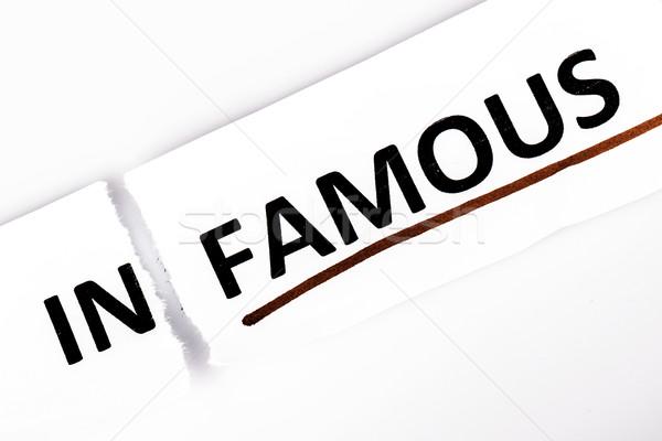 Woord beroemd gescheurd papier witte papier Rood Stockfoto © jarin13