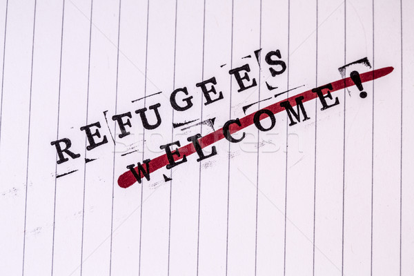 refugees welcome strikethrough text on paper Stock photo © jarin13