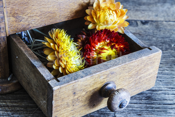 Stock photo: Vintage wooden coffee mill grinder with yellow flowers in open drawer