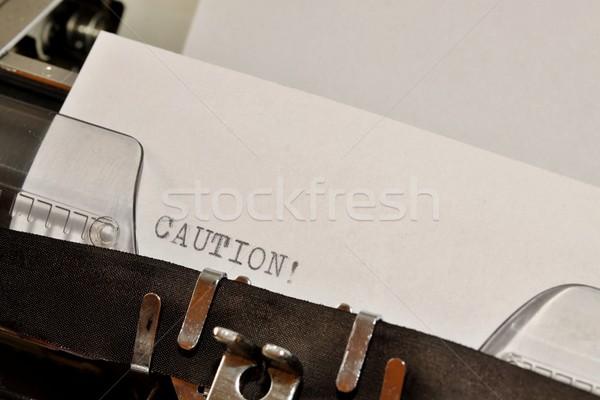 Caution text typed on old black typwriter Stock photo © jarin13