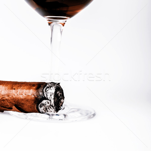 Beautiful cognac with cuban cigar on white background Stock photo © jarin13