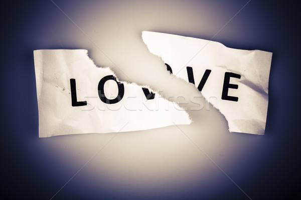 'Love' word written on torn paper Stock photo © jarin13