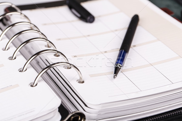 Personal organizer or planner with pen on white background Stock photo © jarin13
