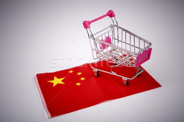 Shopping cart on China flag Stock photo © jarin13