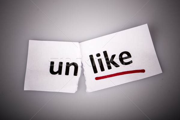 The word unlike changed to like on torn paper Stock photo © jarin13