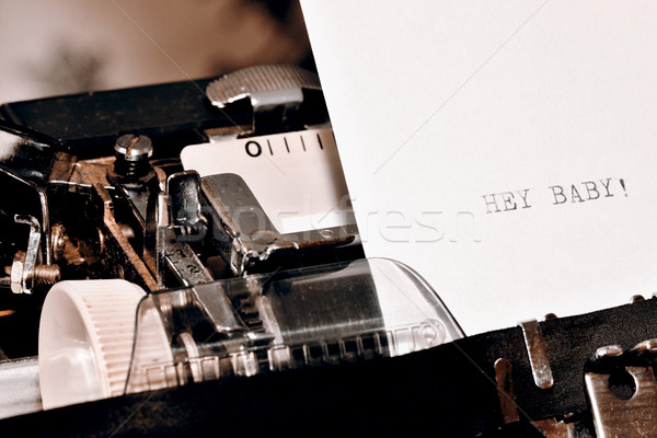 Text Hey Baby typed on old typewriter Stock photo © jarin13
