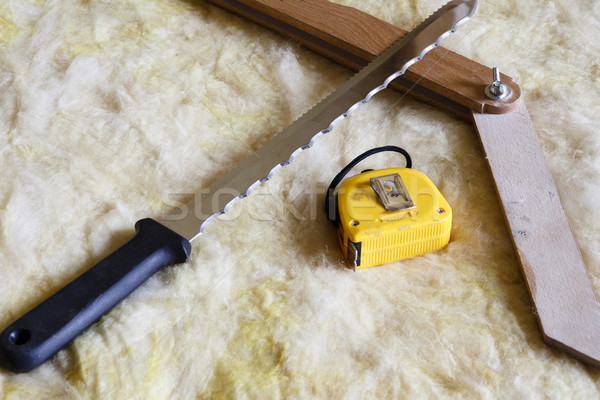 Stock photo: Mineral wool THERMAL INSULATION with meter, knife and protractor