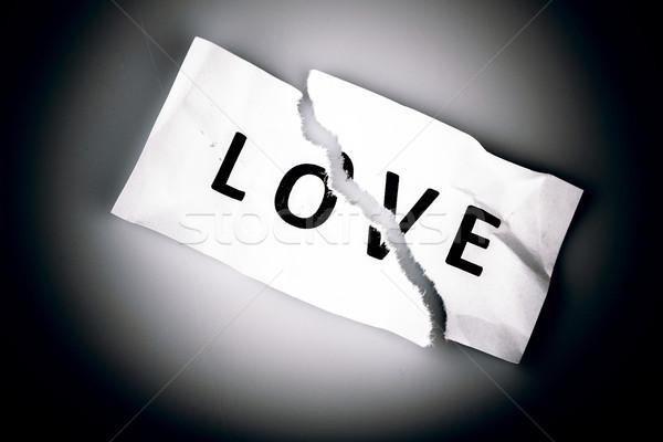 Sevmek kelime yazılı yırtık kağıt beyaz kâğıt Stok fotoğraf © jarin13