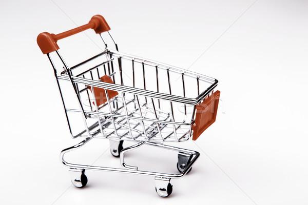 Shopping cart on white background Stock photo © jarin13