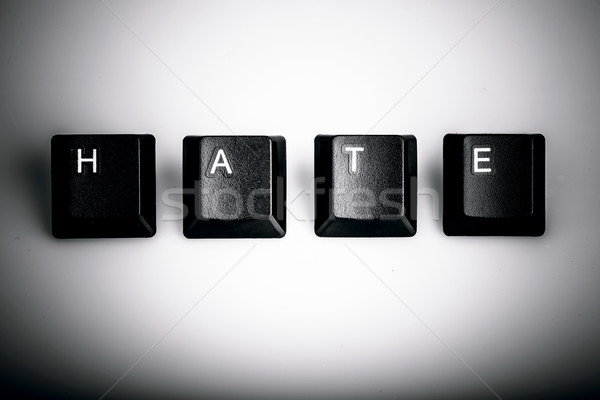 text hate formed with computer keyboard keys on white background Stock photo © jarin13